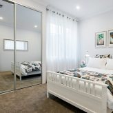Double mirrored sliding robes & walk in robe